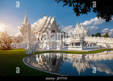 Wat Rong Khun The White Temple with reflection in the pond in Chiang Rai, Thailand. - Stock Photo