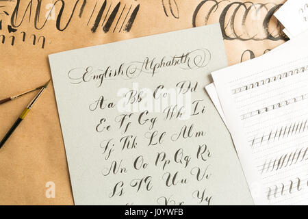 Hand drawn latin calligraphy of brush script. Letters of the alphabet written with a paint brush. Caligraphy, hobby, - Stock Photo