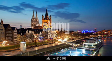 Great Saint Martin Church with Cologne Cathedral, evening dawn, Cologne, North Rhine-Westphalia, Germany - Stock Photo