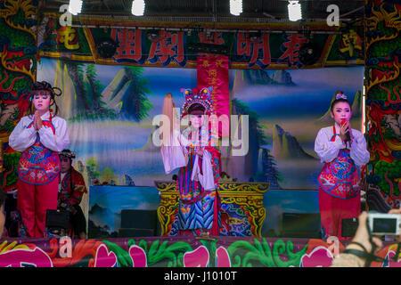 Chinese opera at a temple procession, Yehliu, Wanli District, New Taipei, Taiwan - Stock Photo