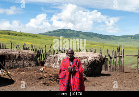 Landscape view with Maasai elder under a sunny blue sky - Stock Photo
