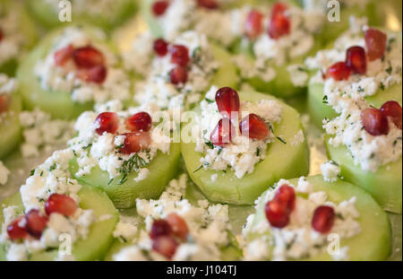 Cucumber Pomegranate and feta canapés with Dill - Stock Photo