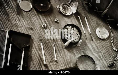 black and white photo watch clock repairing - Stock Photo
