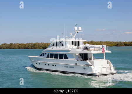 Luxury white motor yacht at the coast in Florida - Stock Photo