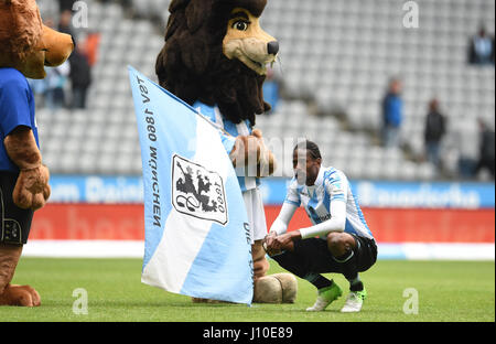 Munich, Germany. 16th Apr, 2017. Lion mascots comfort Munich's Abdoulaye Ba while at play during the German Bundesliga - Stock Photo