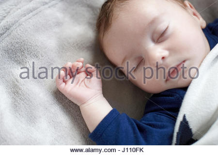 ... 2 Month old new born Baby Boy lying on his back shot overhead - Stock  Photo