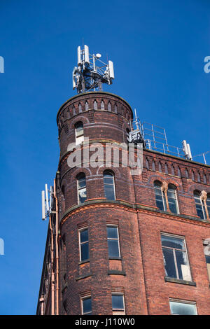 Mobile Phone masts on an old mill building - Stock Photo