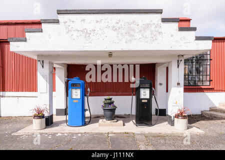 Two Gilbarco (Gilbert and Barker) petrol pumps, circa 1950, at an old fashioned rural independent petrol station - Stock Photo