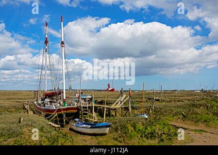 Boats on the saltmarsh, Tollesbury, Essex, England UK - Stock Photo
