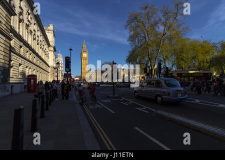 London, England - 9th of April 2017: Tourists near Big Ben and Parliament in the City of Westminster in London on - Stock Photo