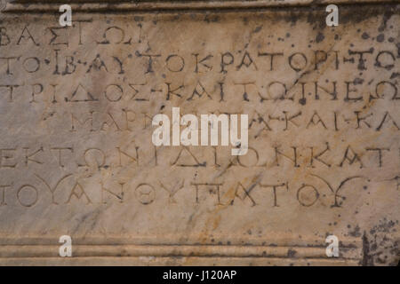 Greek inscription on a block of marble at the ancient ruins of Ephesus, Turkey - Stock Photo