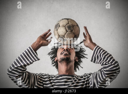 Young black man with football - Stock Photo