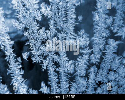 Ice pattern on winter glass natural background - Stock Photo