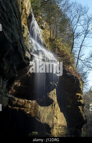 Water cascading over the rocks in the bright spring sunshine.  Tonty Canyon, Starved Rock state park, Illinois. - Stock Photo