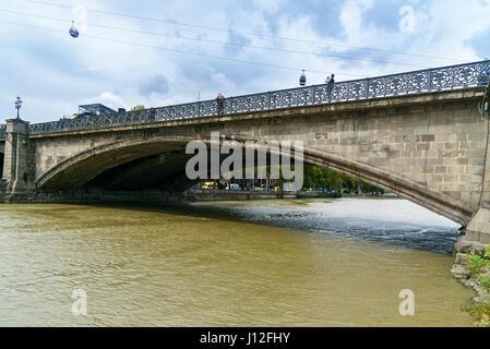 Tbilisi, Georgia - September 24, 2016: View of Metekhi Bridge through Kura River - Stock Photo