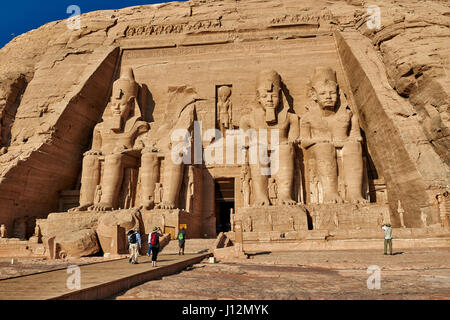 tourists in front of Great Temple of Ramesses II, Abu Simbel temples, Egypt, Africa - Stock Photo
