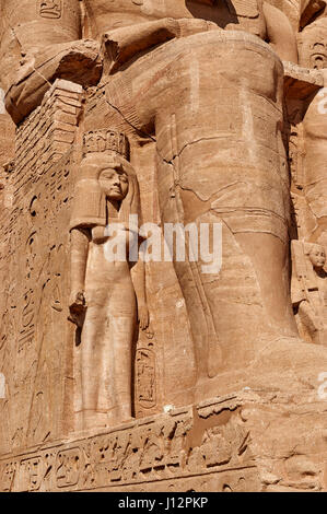 small statue of Nefretari in front of Great Temple of Ramesses II, Abu Simbel temples, Egypt, Africa - Stock Photo