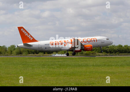 Easyjet Plane G- EZTV Airbus A320-214 landing at Manchester Airport - Stock Photo