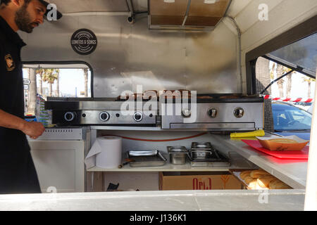 Man Preparing Sausages View Inside Food Truck Interior Spain