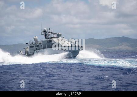 A MK VI patrol boat, assigned to Coastal Riverine Group (CRG) 1 Detachment Guam, maneuvers off the coast of Guam - Stock Photo