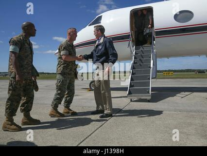 U.S. Marine Corps Col. Peter D. Buck, commanding officer of Marine Corps Air Station Beaufort (MCAS),  greets Secretary - Stock Photo