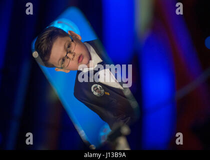 A child is reflected in a telemprompter as Mike Krzyzewski, head men's basketball coach at Duke University and USA - Stock Photo