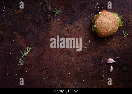 Delicious fresh homemade burger on a rustic table. Menu frame. View from above, space for text. - Stock Photo