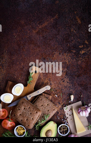 Veggie burger with avocado, cheese and egg on wooden board. Top view, flat lay. Vegetarian. - Stock Photo