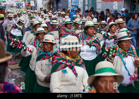 Dancers in colourful costumes parading through the mining city of Oruro on the altiplano of Bolivia at the start - Stock Photo