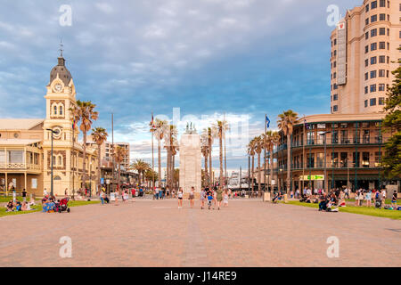 Adelaide, Australia - August 29, 2016: People walking at Moseley Square with Pioneer Memorial in the middle at sunset. - Stock Photo