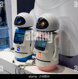 Robots, male and female, at a technology conference in Shenzhen, China - Stock Photo