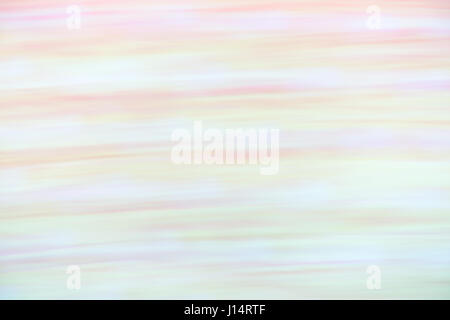 Abstract motion blur in lavender, purple, orange, green and pink - Stock Photo