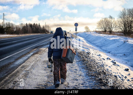 Winter fisherman walk fishing - Stock Photo
