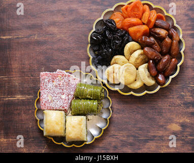 Oriental sweets (baklava, rahat loachum) and dried fruits - Stock Photo