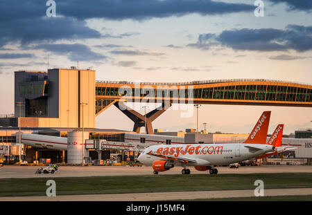 Easyjet plane waiting on the apron at Gatwick airport, near London, United Kingdom. - Stock Photo