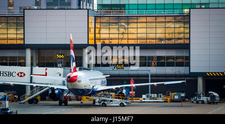 British Airways plane waiting on the apron at Gatwick airport, near London, United Kingdom. - Stock Photo