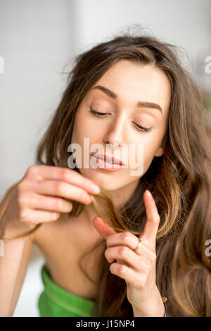 Woman having problems with hair - Stock Photo