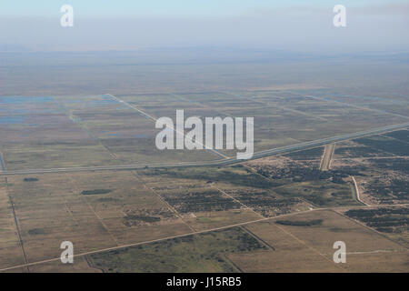 Aerial view of sugar cane fields, farmlands and drainage canals in the Everglades Agricultural area, Florida - Stock Photo
