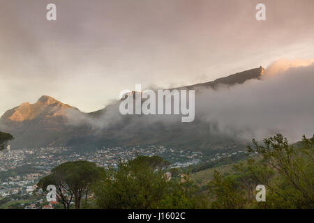 Clouds rolling In over Table Mountain ,a prominent landmark overlooking the City Of Capetown, South Africa - Stock Photo