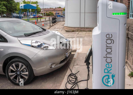 Electric Car charging point in action. - Stock Photo