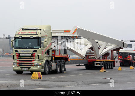 NAANTALI, FINLAND - APRIL 9, 2016: Scania R620 and industrial object on drop deck trailer as oversize load parked - Stock Photo