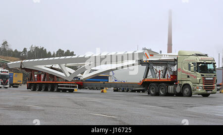 NAANTALI, FINLAND - APRIL 9, 2016: Scania R620 and long industrial object on drop deck trailer as oversize load. - Stock Photo