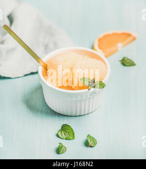 Pink grapefruit homemade sorbet with fresh mint leaves - Stock Photo