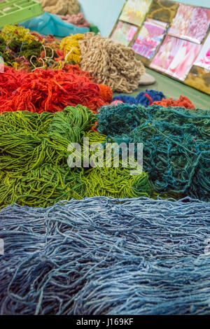Silk thread colored in different colors in a silk factory - Stock Photo