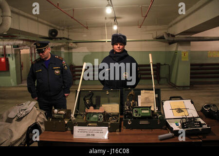 MOSCOW, RUSSIA: Bunker security guards display old-fashioned looking radiation detectors and gas masks. HAVE YOU - Stock Photo