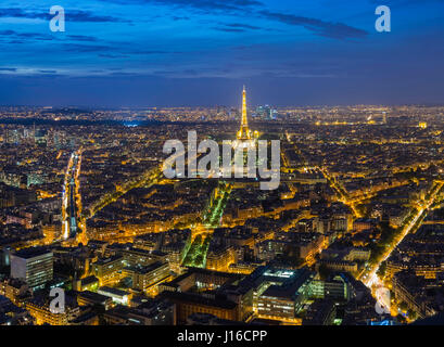 PARIS, FRANCE: The Eiffel Tower is lit up at dusk. A BRITISH aerial photographer has captured the human-built world - Stock Photo
