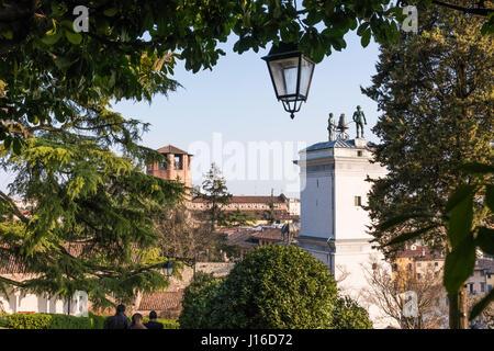 Statues with clock on Loggia di San Giovanni in Udine, Italy - Stock Photo