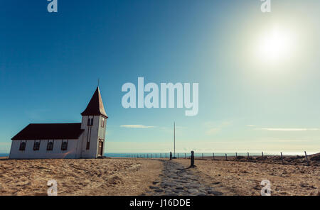 The sun beats down over the church in Hellnar, a fishing village on the Snæfellsnes (Snaefellsnes) peninsula, western - Stock Photo