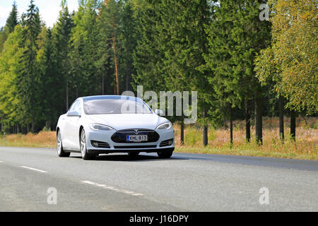 HUMPPILA, FINLAND - SEPTEMBER 12, 2015: Tesla Model S electric car on the road. Tesla's autopilot technology is - Stock Photo