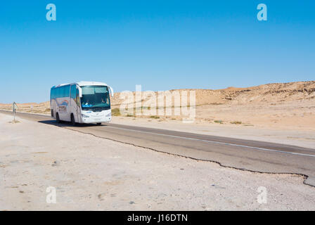 CTM bus, N1 road, between Boujdour and Dakhla, Western Sahara, administered by Morocco, Africa - Stock Photo